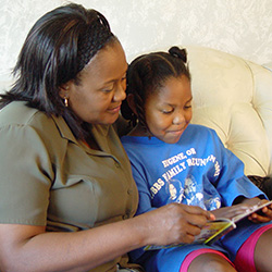 Photo of Mother and Daughter Reading